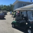 Carts were lined up and marked for each team before the shotgun start.