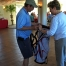 Jean Cronin, Assistant Director of CPSA, hands a raffle winner his brand new golf bag!