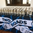 Two Roads welcomed guests with craft beer glasses, stickers, and bottle openers to take home.